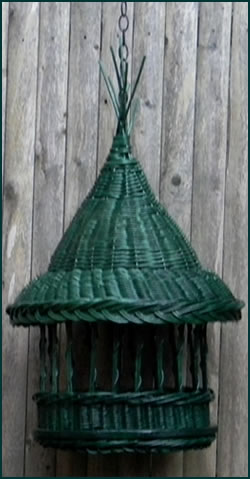 Handwoven birdfeeder from green colored reed by basket artist Tina Puckett