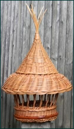 Birdfeeder woven from natural colored reed by master weaver Tina Puckett of Winsted, CT