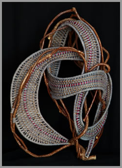 C-8, a whimsical woven wallhanger made by American basket artist Tina Puckett of Winsted, CT
