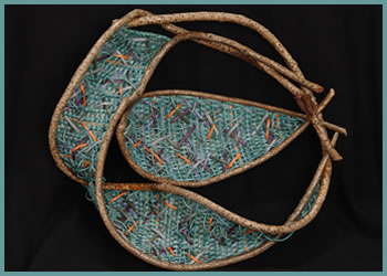 Fish Bowl, a whimsical wallhanging sculpture by master basket weaver Tina Puckett
