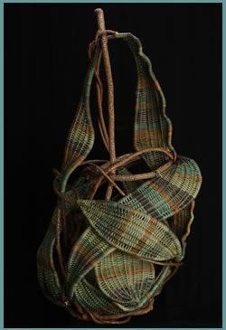 Pear is a free-standing woven sculpture by master basket weaver Tina Puckett