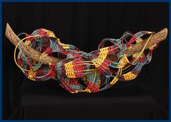 Play on Circles is a woven sculpture by basket weaver Tina Puckett