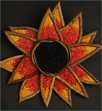 Colorful Sunflower, a sunflower wall sculpture woven by basketry artist Tina Puckett of Winsted, CT