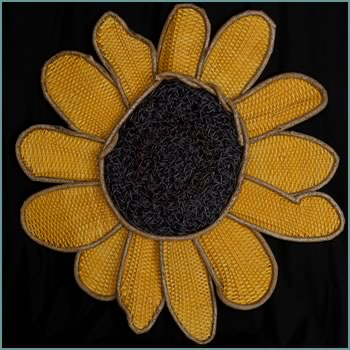 The commissioned woven sunflower woven by Tina Puckett