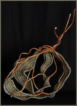 Whimsical is a free-standing woven sculpture by master weaver Tina Puckett of Winsted, CT